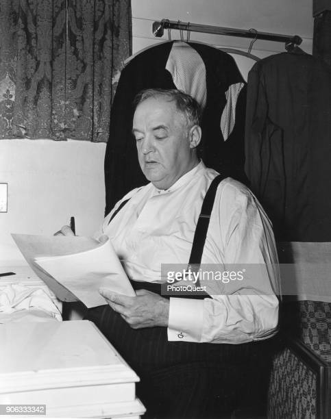 In a dressing room Britishborn American actor Sydney Greenstreet reads a script for his role in 'Conflict' Hollywood California 1945