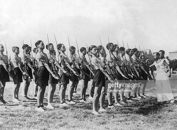 In a Fascist camp in Rome, AVANGUARDISTI troops were inspected during physical exercises, on July 30, 1934. The AVANGUARDISTI spent their vacation in...