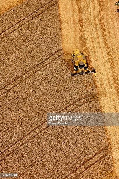 In a Field just outside Winchester a combine Harvestor collects wheat in this aerial photo taken on 25th July 2006