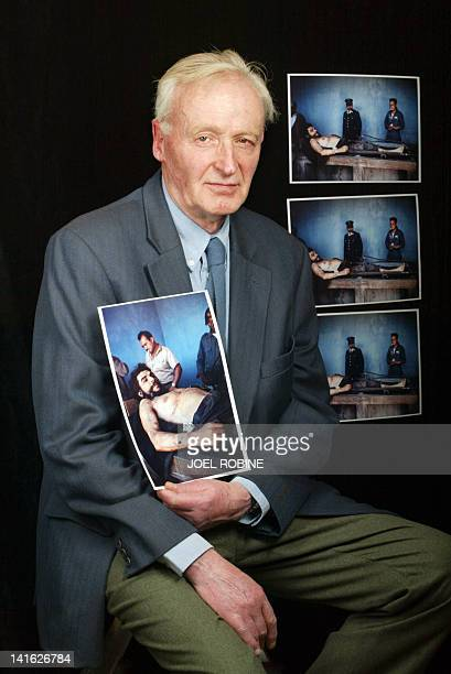 In a file picture taken on 13 December 2002 Former AFP journalist French Marc Hutten poses with the picture he took of the body of Ernesto Che...