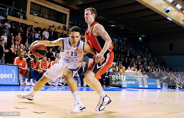 In a file picture taken on January 08 2011 Poitiers' Evan Fournier vies with Chalon's Nicolas Lang during their French pro A basketball match...