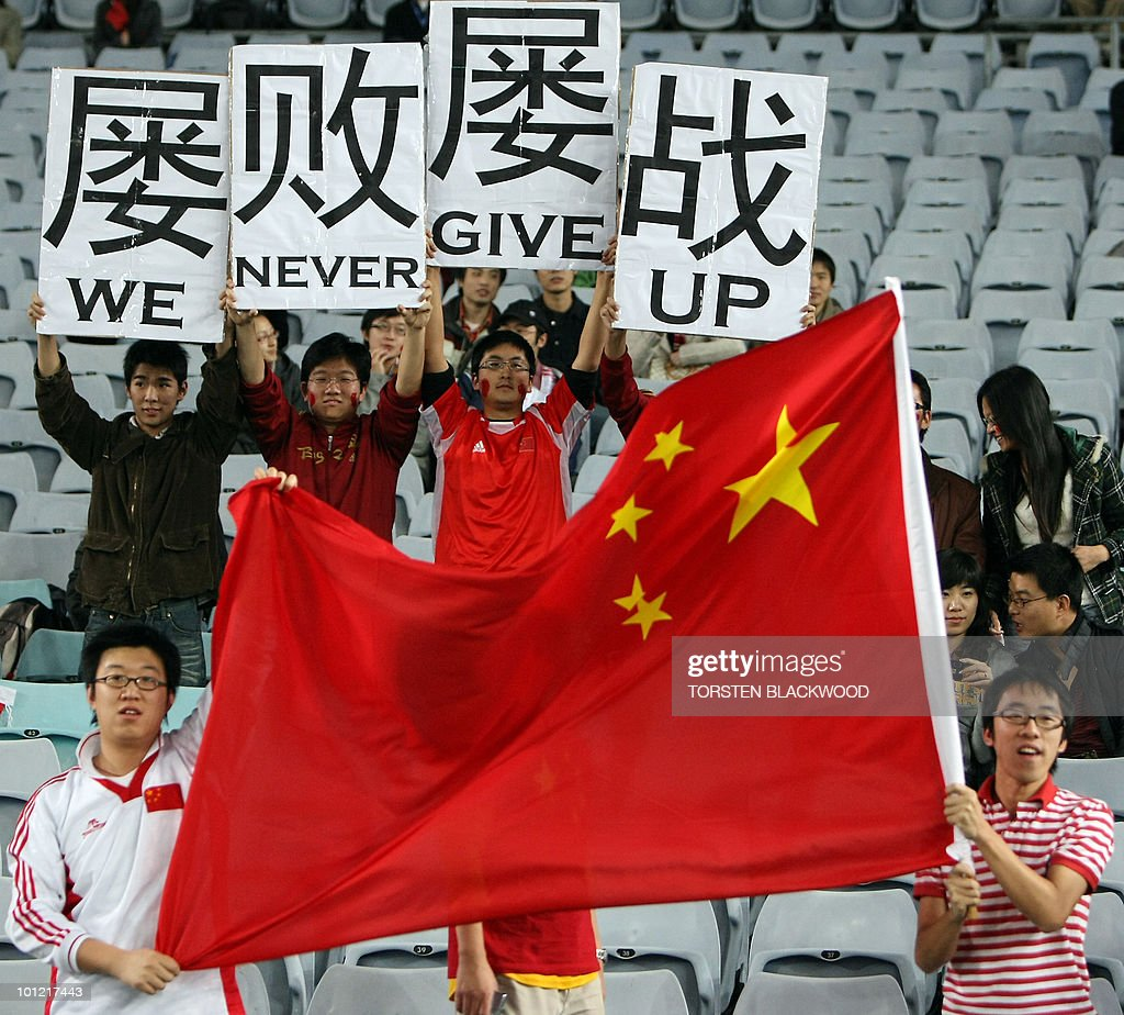 In a file picture taken on June 22, 2008, Chinese fans cheer on their team during the warm-up session for the Football World Cup qualifier against the Australia in Sydney. It might be the most populous country in the world, and one with the most potential, but China seems incapable of putting together a football team that can make the World Cup. AFP PHOTO/Torsten BLACKWOOD