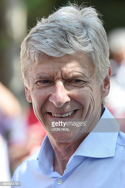 In a file picture taken on May 18 2014 Arsenal's French manager Arsene Wenger smiles during their victory parade in London following their win in the...