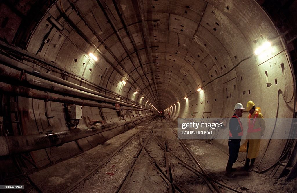 In a file picture taken on November 27, 1990 Technicians work on the construction site of the Channel tunnel in Sangatte, northern France. Fearing an invasion of rabid animals, terrorists, immigrants and the loss of their cherished island isolation, many Britons were highly suspicious of the Channel Tunnel. Today, with May 6, 2014 marking the 20th anniversary of opening of the Channel Tunnel, Eurotunnel supporters quote playwright William Shakespeare to describe the scare-stories as 'much ado about nothing'.