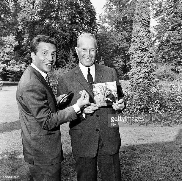 In a garden Albert Raisner and Maurice Chevalier present the record of the duet of Maurice Chevalier with Gigliola Cinquetti Shooting for the...