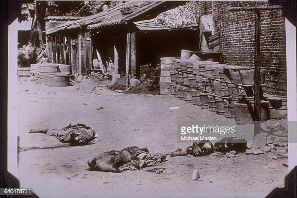 In a ghastly scene cutup bodies lay after their execution in Canton China ca 1930