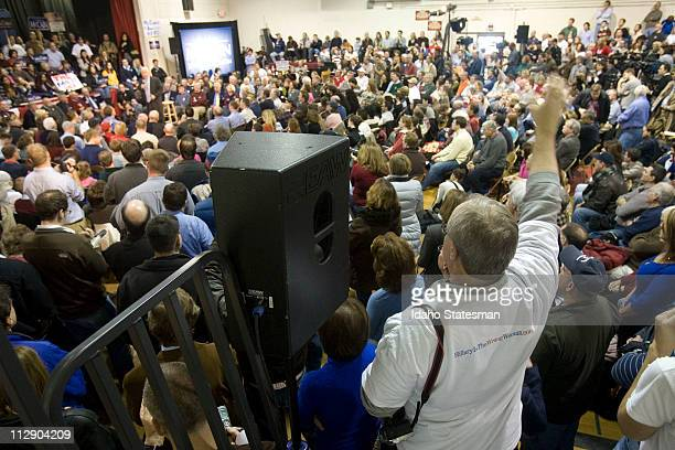 In a gymnasium filled to capacity New Hampshire voters ask Republican presidential candidate Sen John McCain a variety of questions during a town...
