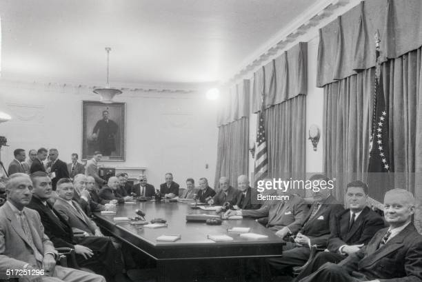 In a history-making television appearance, the members of President Eisenhower's Cabinet are seen by the viewing public during a special meeting to...