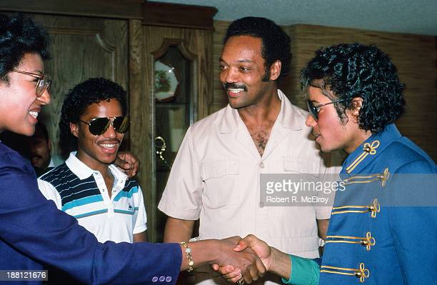 In a hotel room during the 1984 Democratic National Convention American sibling pop singers Marlon and Michael Jackson attend a press conference with...