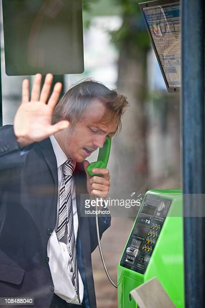 in a hurry - telephone booth stock pictures, royalty-free photos & images