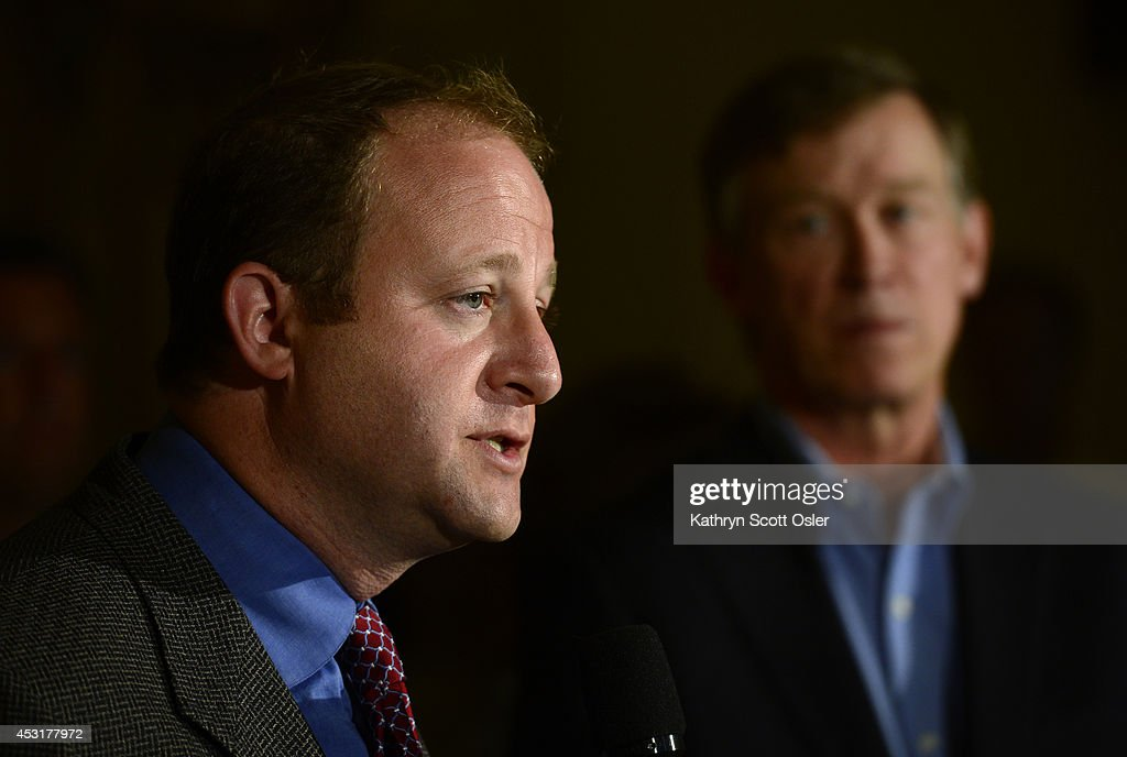 In a joint press conference inside the state capitol, Gov. John Hickenlooper and U.S. Rep. Jared Polis, D-Boulder, announce the formation of a task force to craft legislation to minimize conflict over the siting of oil and gas facilities in Colorado. : News Photo