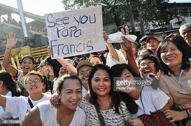 In a joyous mood crowd waves and cheers as Pope Francis pass by along Quirino Avenue on his way to the airport for his departure on Monday