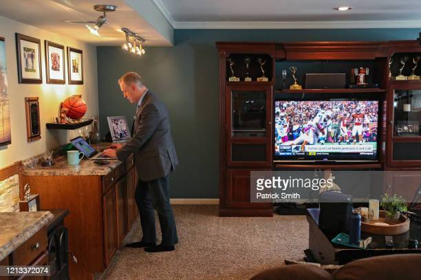 In a makeshift television studio WBALSports Anchor/Reporter Pete Gilbert checks his script following recording a standup report on the 2020 NFL Free...