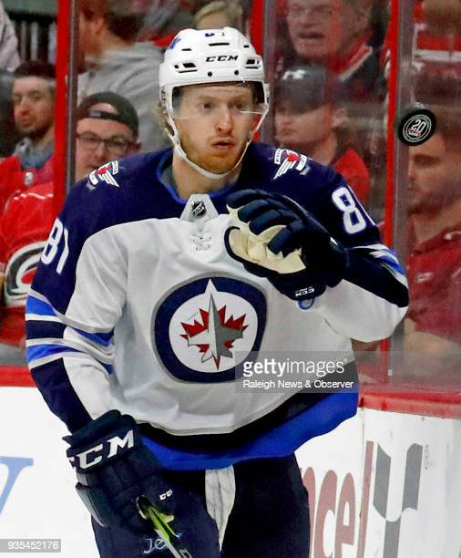 In a March 4 file image the Winnipeg Jets' Kyle Connor keeps his eyes on a flying puck against the Carolina Hurricanes at PNC Arena in Raleigh NC On...