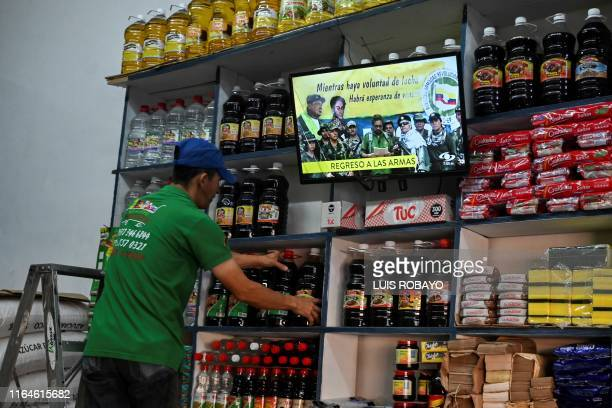 In a market in Cali, Colombia, broadcasts on August 29, 2019 a video posted on YouTube of former senior commander Ivan Marquez and fugitive rebel...