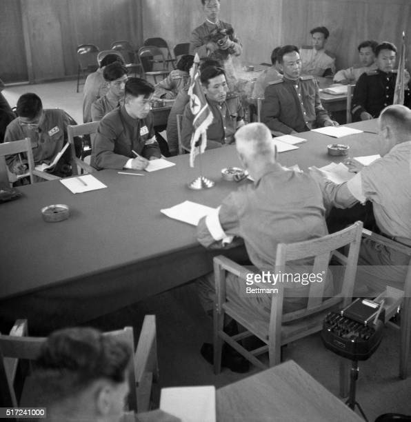 In a meeting at the site of last year's Korean truce agreement Communist officials receive a warning from United States officers US Navy Commander...