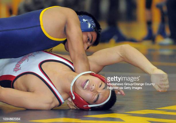 BEACH In a Moore League wrestling match Millikan defeated Lakewood Millikan's Angel Castellanos nearly pins Matt Tsunawaki but ended up winning with...