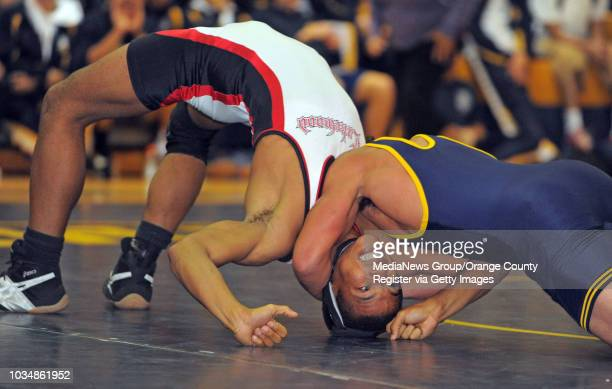BEACH In a Moore League wrestling match Millikan defeated Lakewood Lakewood's Elijah Brown tries to avoid the pin by Millikan's Kenny Brewer but...