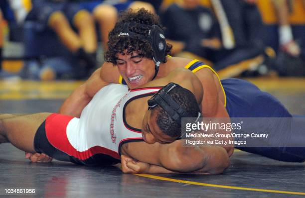 BEACH In a Moore League wrestling match Millikan defeated Lakewood Millikan's Kenny Brewer beat Lakewood's Elijah Brown on a decision in the 160pound...