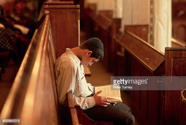 In a Moscow synagogue a young man reads