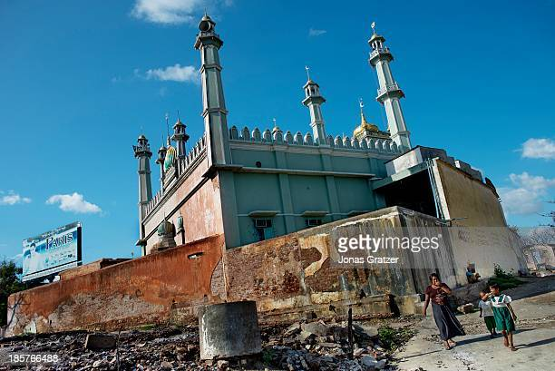 In a Muslim neighborhood the mosque was the only building that survived after waves of violence led against Muslims by Buddhists have destroyed and...