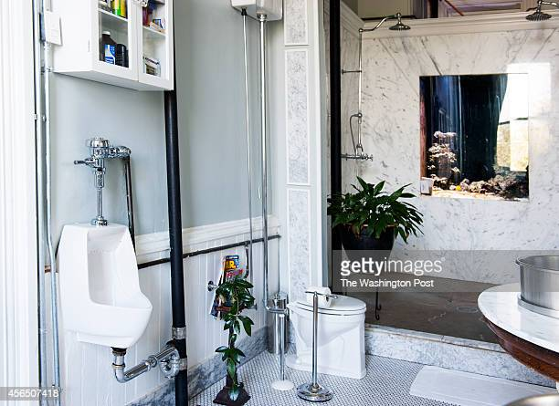In a nod to the former schoolhouse a urinal is in the master bathroom along with a salt water fish tank in the shower September 30 2014 in Washington...