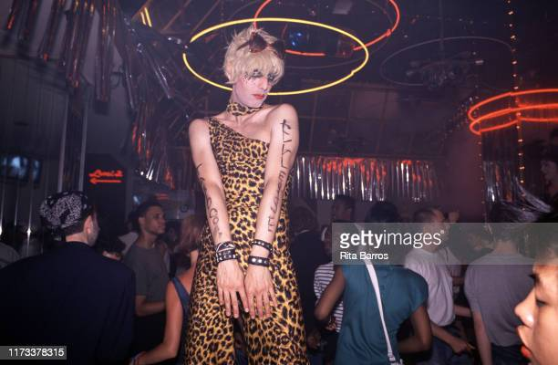 In a one-shoulder, leopard print outfit, drag performer Tabboo poses on the dancefloor at Bentley's nightclub, New York, New York, 1988.