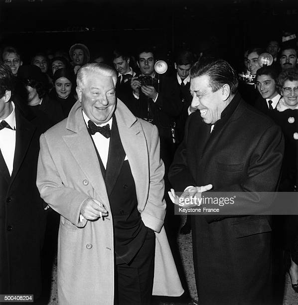 In a Parisian movie theatre actors and friends Jean Gabin and Fernandel joke around during the presentation of Gilles Grangier's film 'That Tender...