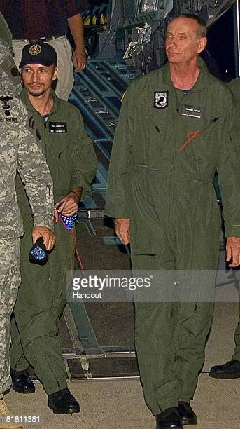 In a photo released by the US Air Force military contractors Mark Gonsalves and Thomas Howes step off an US Air Force C17 Globemaster III July 2 2008...