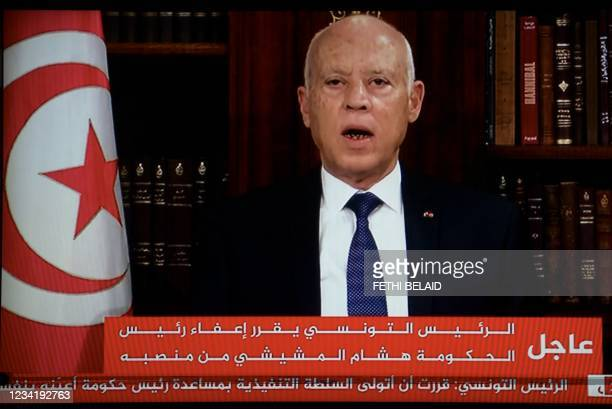 In a photo taken from the television station of President Kais Saied, Presidnet Saied announces, the dissolution of parliament and Prime Minister...