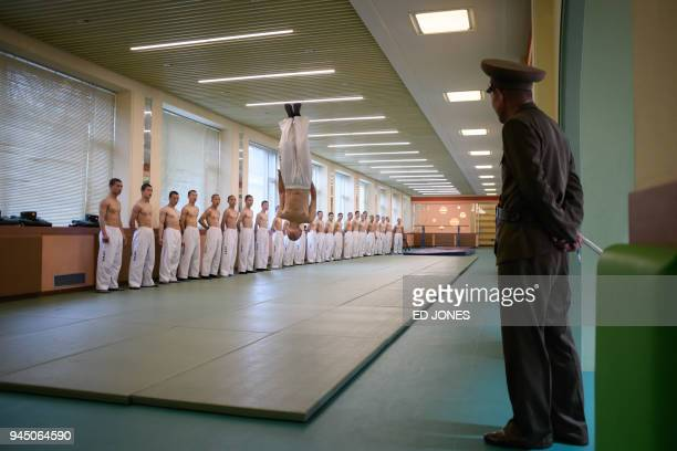 TOPSHOT In a photo taken on April 10 2018 students perform a taekwondo demonstration at the Mangyongdae Revolutionary Academy outside Pyongyang The...