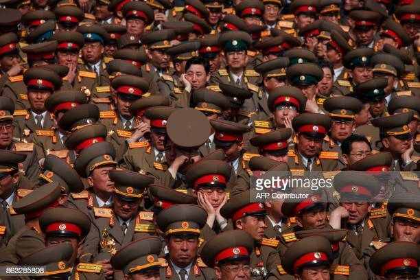 In a photo taken on April 15 2012 North Korean People's Korean Army soldiers wait for the start of a mass military parade marking the 100th birthday...