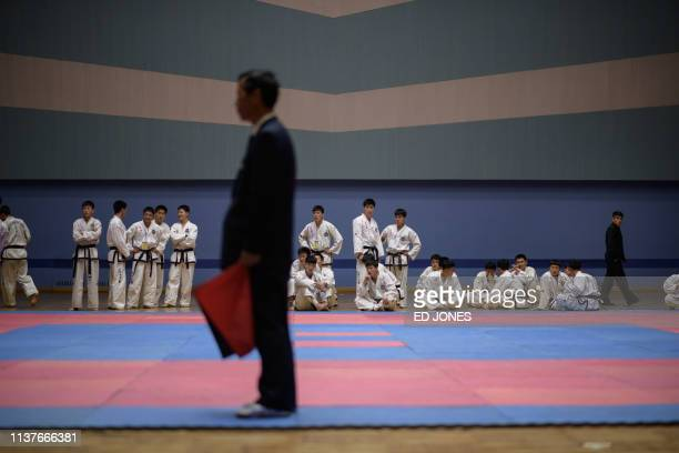 TOPSHOT In a photo taken on April 16 2019 competitors wait to take part in the Mangyongdae Prize martial arts competition held as part of the...
