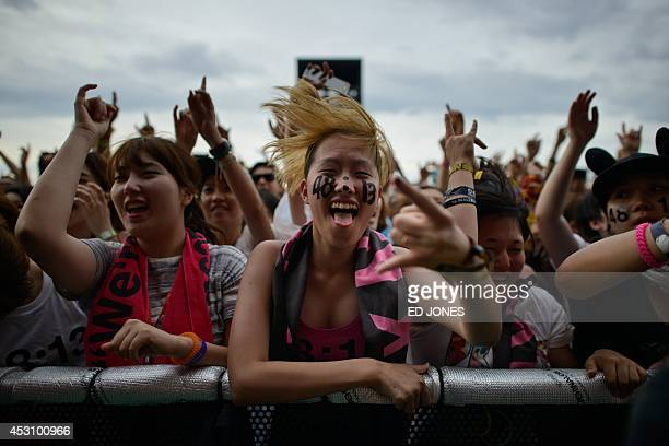 In a photo taken on August 2 a reveller gestures during a performance by US band 'Boys Like Girls' on the main stage at the Pentaport Rock Festival...