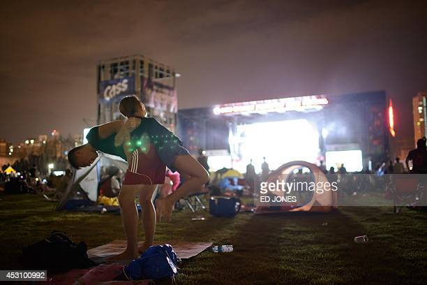 In a photo taken on August 2 revellers listen to British band 'Kasabian' perform at the Pentaport Rock Festival in Incheon The annual threeday...