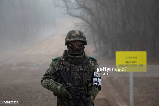 In a photo taken on December 3 2018 a South Korean soldier stands before the Military Demarcation Line separating North and South Korea on the...