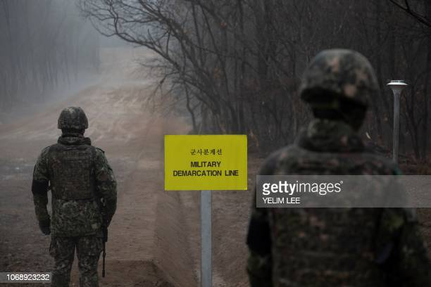 In a photo taken on December 3 2018 South Korean soldiers stand before the Military Demarcation Line separating North and South Korea on the southern...