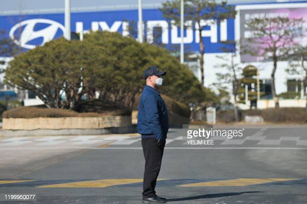 In a photo taken on February 10 2020 a security guard stands at the entrance to the Hyundai Motor Asan Factory in Asan south of Seoul Hyundai has had...