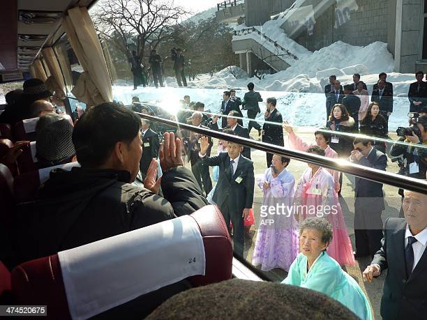 In a photo taken on February 22 2014 South Koreans aboard a bus wave goodbye to their North Korean relatives as they leave a family reunion at the...