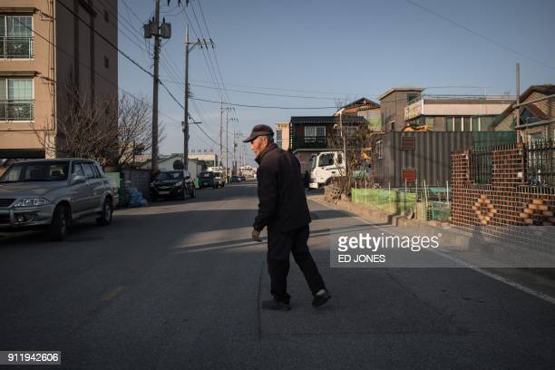 In a photo taken on January 15 North Korean refugee Kim KunWook walks to his car in 'Abai village' a settlement originally created by North Korean...
