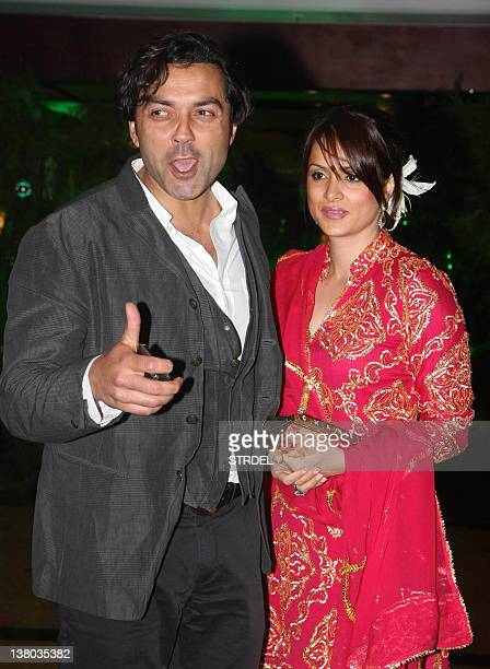 In a photo taken on January 31 Indian Bollywood actor Bobby Deol and his wife Tanya attend the wedding ceremony of Ritesh Deshmukh and Genelia...