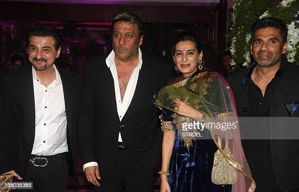 In a photo taken on January 31 Indian Bollywood actor Suniel Shetty and his wife Mana Shetty Jackie Shroff and Sanjay Kapoor attend the wedding...
