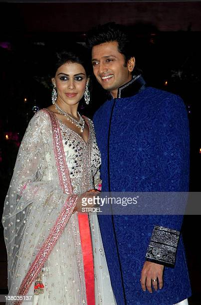 In a photo taken on January 31 Indian Bollywood couple Ritesh Deshmukh with Genelia D'souza attend during a wedding ceremony in Mumbai AFP PHOTO