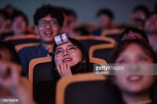In a photo taken on July 11 spectators watch as professional eSports teams 'Griffin' and 'Afreeca Freaks' prepare to compete in a 'League of Legends'...