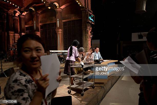 In a photo taken on July 13 2013 cast and crew members of weekly entertainment show Saturday Night Live Korea rehearse on set at a studio in Seoul...