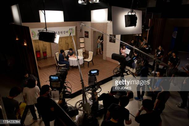 In a photo taken on July 13 2013 cast members of weekly entertainment show Saturday Night Live Korea rehearse on set at a television studio in Seoul...