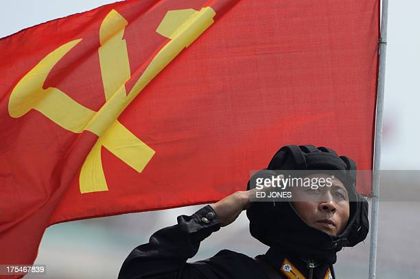 In a photo taken on July 27 2013 a North Korean soldier salutes during a march through Kim IlSung square at a military parade marking the 60th...