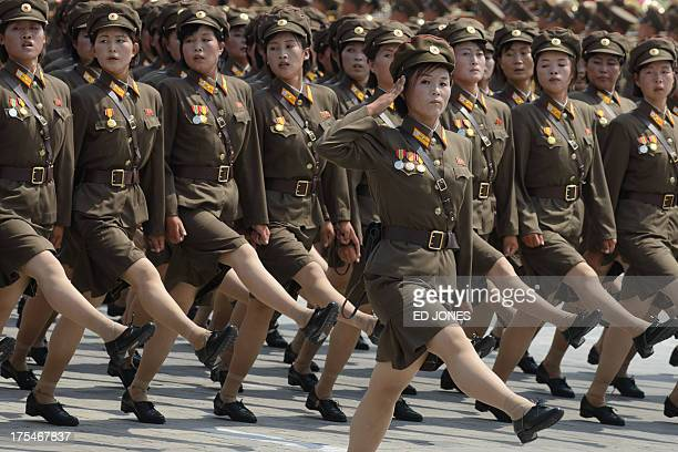 In a photo taken on July 27 2013 female North Korean soldiers march through Kim IlSung square during a military parade marking the 60th anniversary...