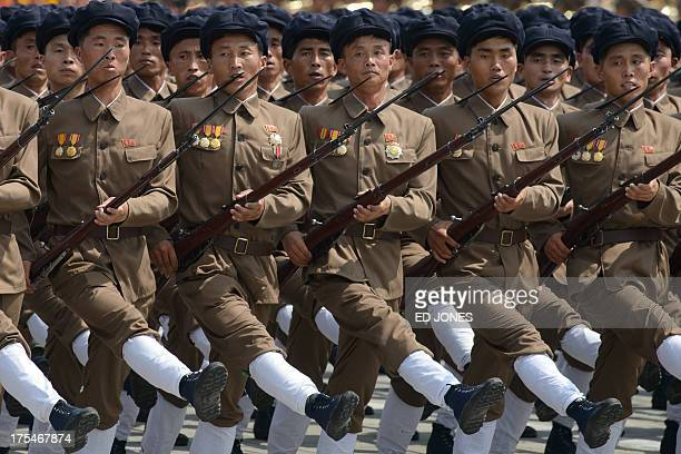 In a photo taken on July 27 2013 North Korean soldiers march through Kim IlSung square during a military parade marking the 60th anniversary of the...