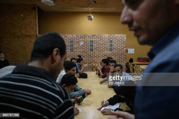 In a photo taken on July 4 Yemeni asylum seekers looking for accomodation write their names on a list during a gathering at the Olle Tourist Hotel in...